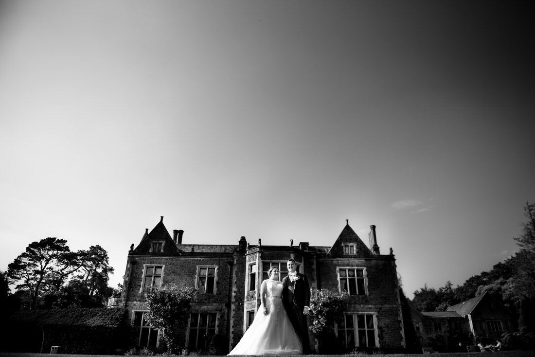 Miskin Manor Wedding Photo of newly married couple kissing in front of manor house