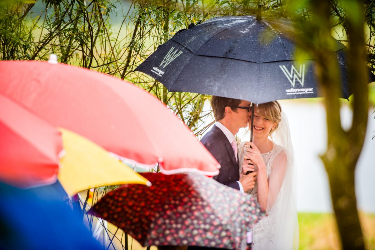 Bride and Groom saying there wedding vows on a rainy day at their alternative wedding