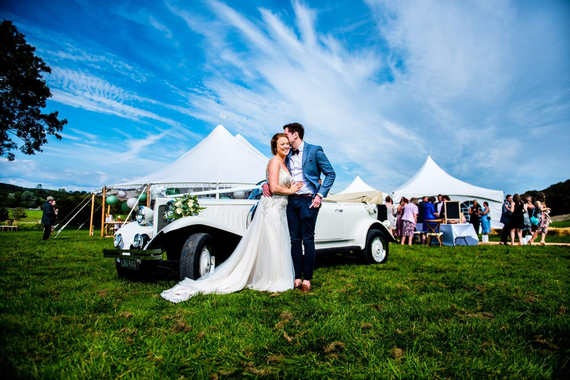 birde and groom laughing at their festival wedding south wales