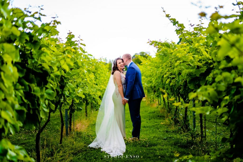 Lanerch Vineyard Wedding Photo of newly married couple kissing in the vineyard